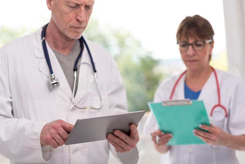 Portrait of female and male doctors stock photo