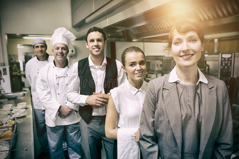 Portrait of female manager posing with staff royalty free stock photos
