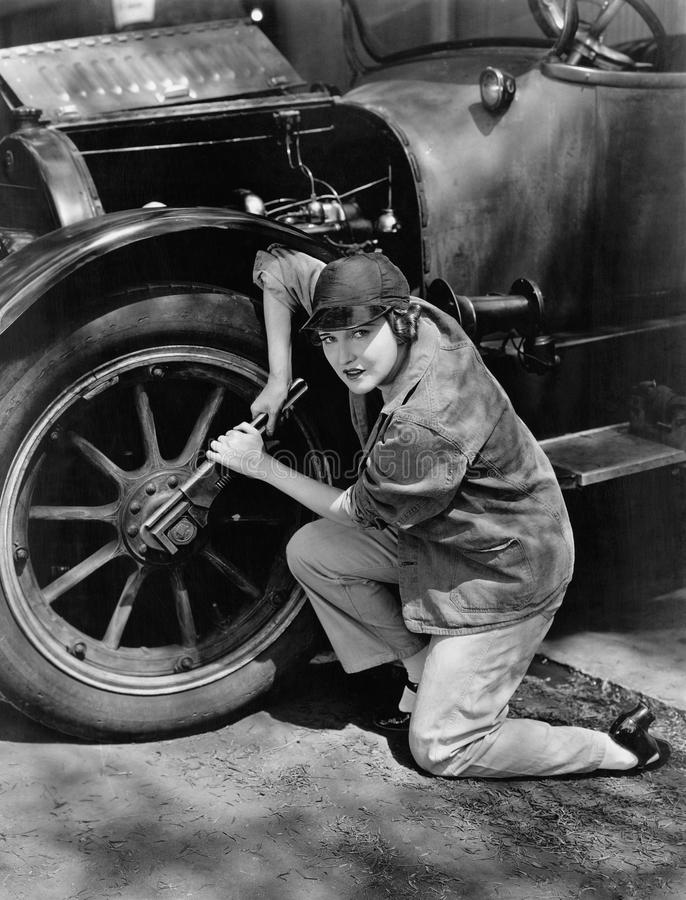 Portrait of female mechanic working. (All persons depicted are no longer living and no estate exists. Supplier grants that there will be no model release issues royalty free stock photos
