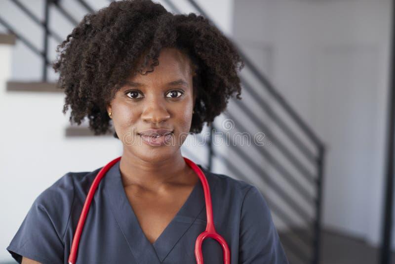 Portrait Of Female Nurse Wearing Scrubs In Hospital royalty free stock photo
