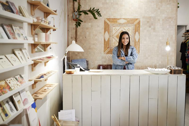 Portrait Of Female Owner Of Independent Clothing And Gift Store Behind Sales Desk stock image