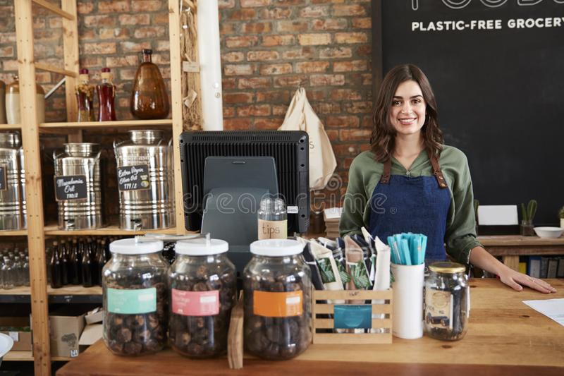 Portrait Of Female Owner Of Sustainable Plastic Free Grocery Store Behind Sales Desk stock image
