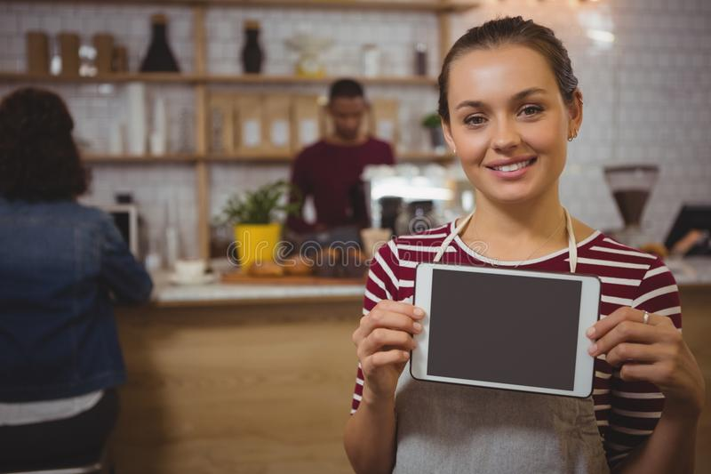 Portrait of female owner with tablet in cafe stock photos