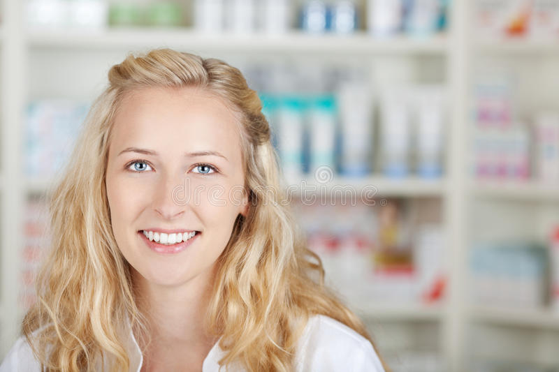 Portrait Of A Female Pharmacist At Pharmacy royalty free stock image
