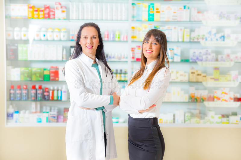 Portrait of female pharmacists. In drugstore stock images