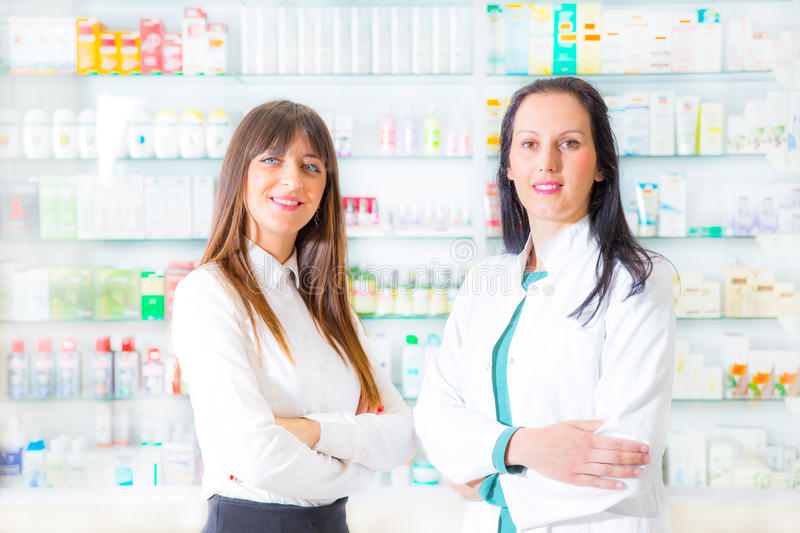 Portrait of female pharmacists. In pharmacy drugstore, selective focus royalty free stock image