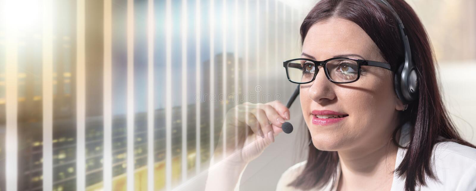 Portrait of female phone operator with headset; multiple exposure stock photography