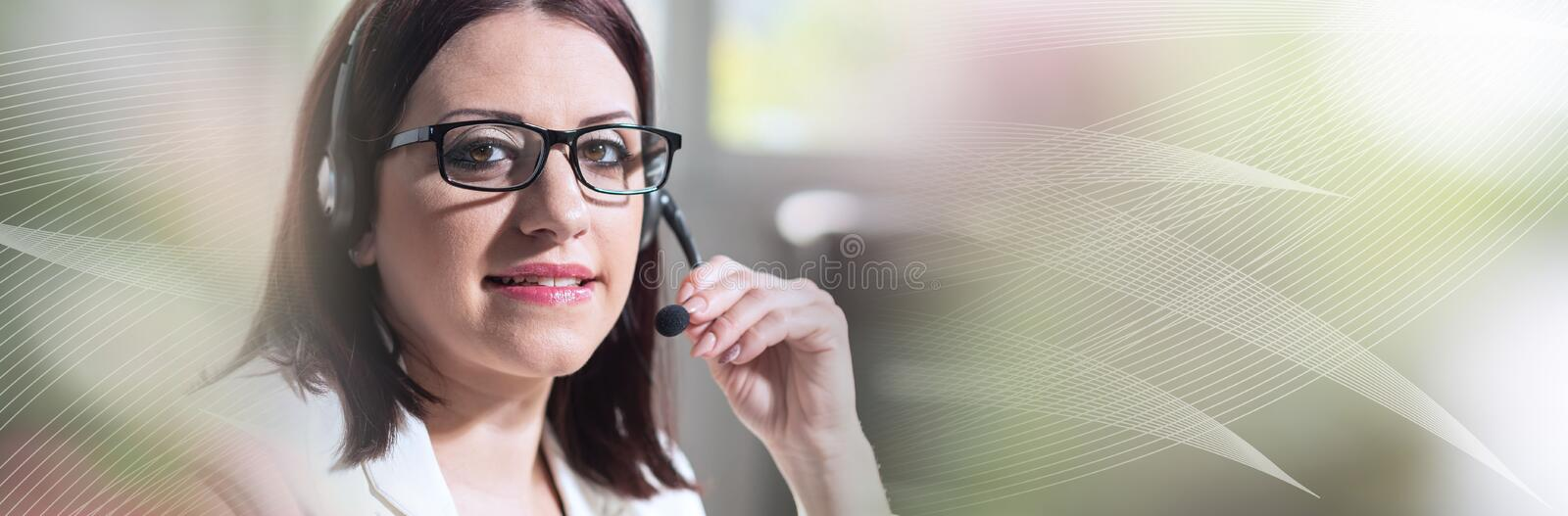 Portrait of female phone operator with headset; panoramic banner stock images