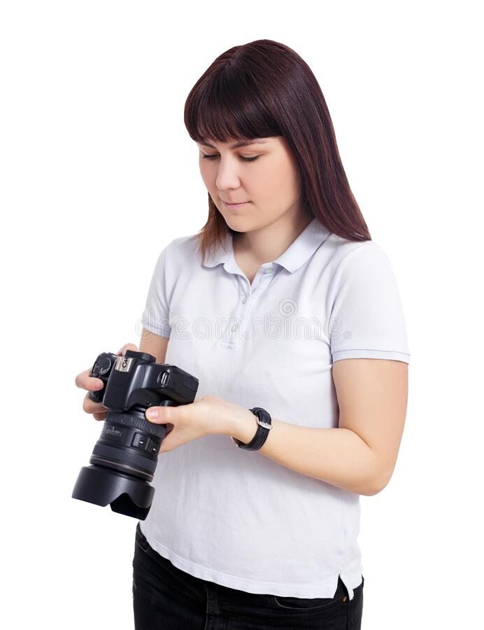 Portrait of female photographer or videographer watching video or photos on her camera isolated on white royalty free stock image