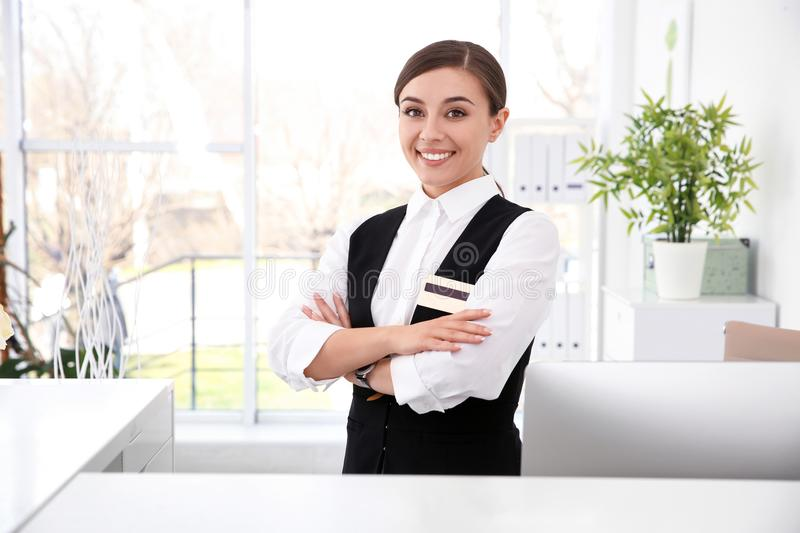 Portrait of female receptionist at workplace stock photo