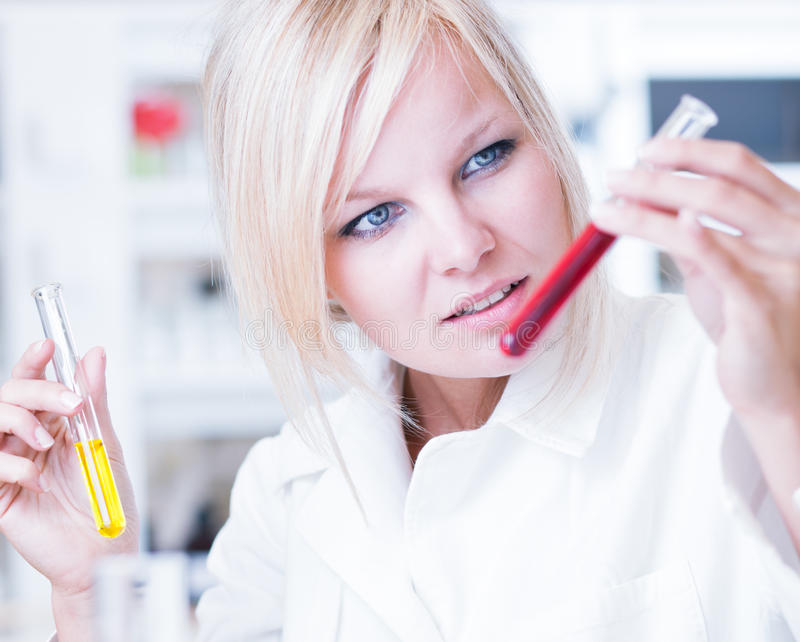 Portrait of a female researcher/chemistry student. Carrying out research in a lab stock images