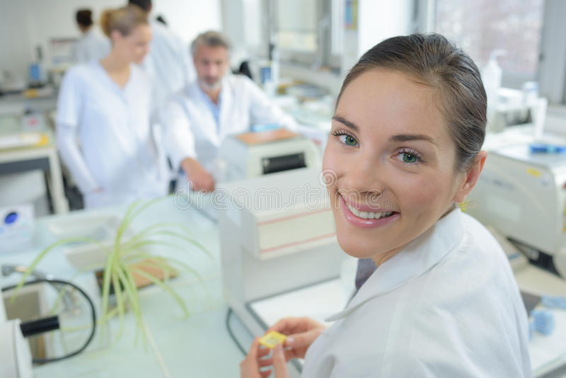 Portrait female researcher doing research in lab royalty free stock photography