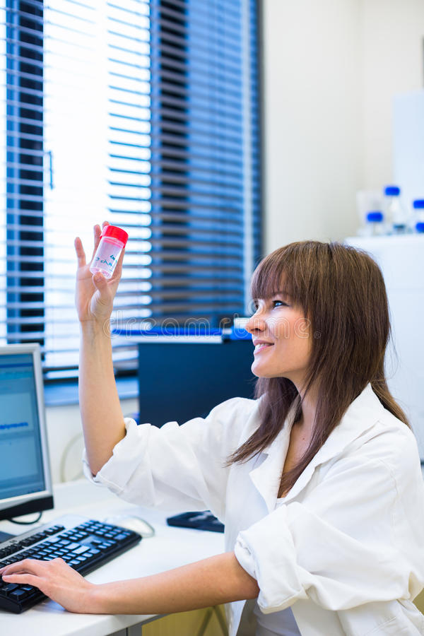 Portrait of a female researcher in a lab. Portrait of a female researcher carrying out research in a chemistry lab (color toned image; shallow DOF royalty free stock images