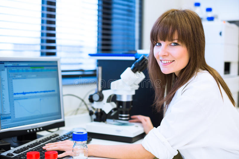 Portrait of a female researcher in a lab. Portrait of a female researcher carrying out research in a chemistry lab (color toned image; shallow DOF royalty free stock photos