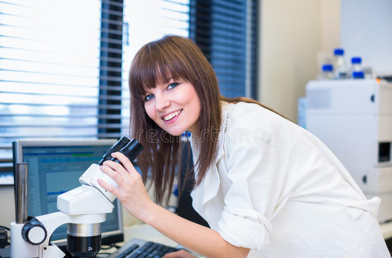 Portrait of a female researcher in a lab. Portrait of a female researcher carrying out research in a chemistry lab (color toned image; shallow DOF stock photo