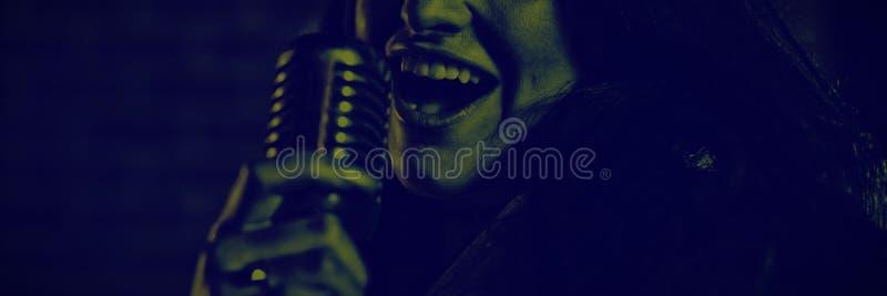 Portrait of female singer performing in nightclub. Close up portrait of female singer performing in nightclub stock photos