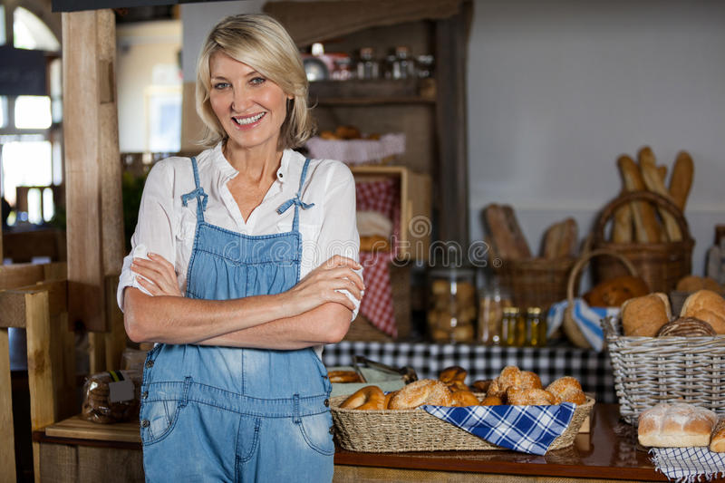 Portrait of female staff standing with arms crossed royalty free stock image