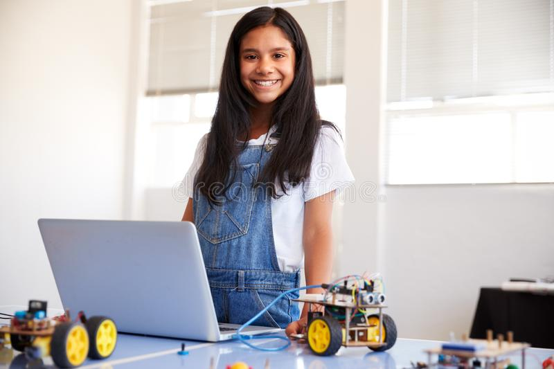 Portrait Of Female Student Building And Programing Robot Vehicle In School Computer Coding Class royalty free stock photography