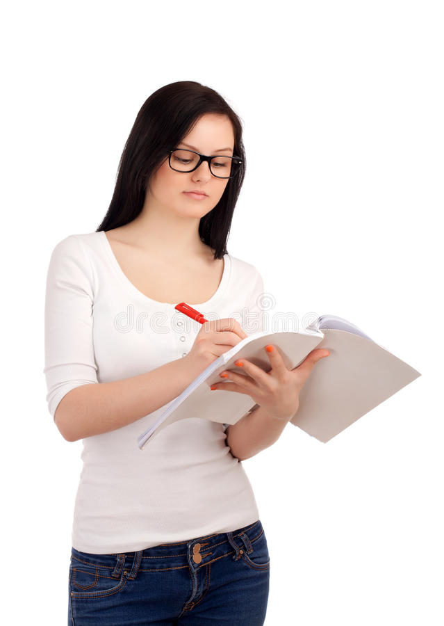 Portrait of female student with books stock image