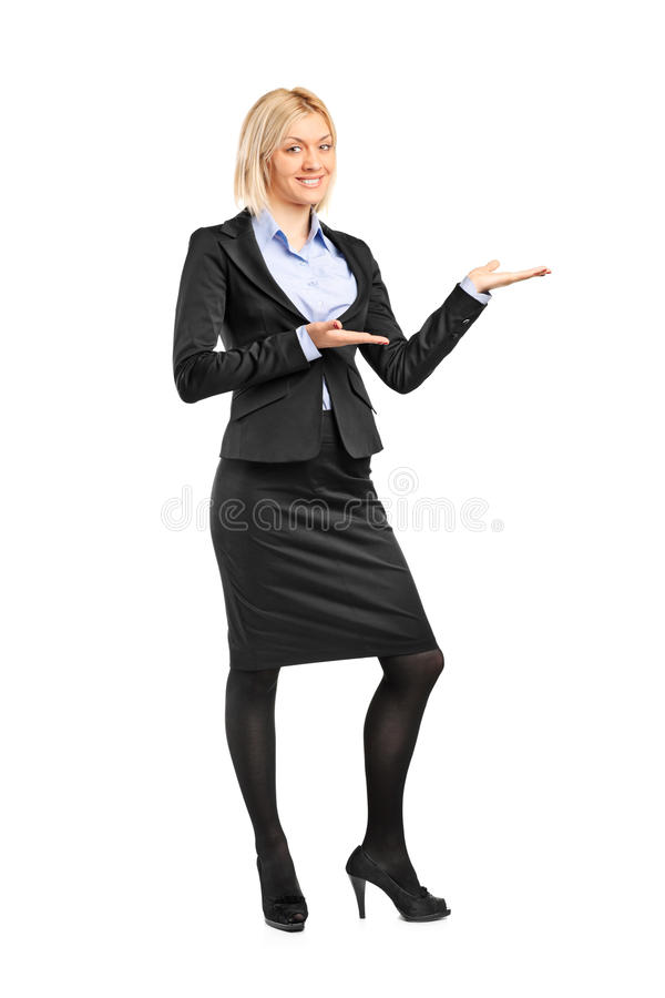 Download Portrait Of A Female In Suit Gesturing Welcome Stock Photo - Image of portrait, black: 20260572