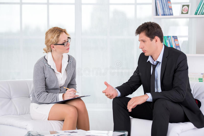 Portrait of female therapist in office with her royalty free stock photography
