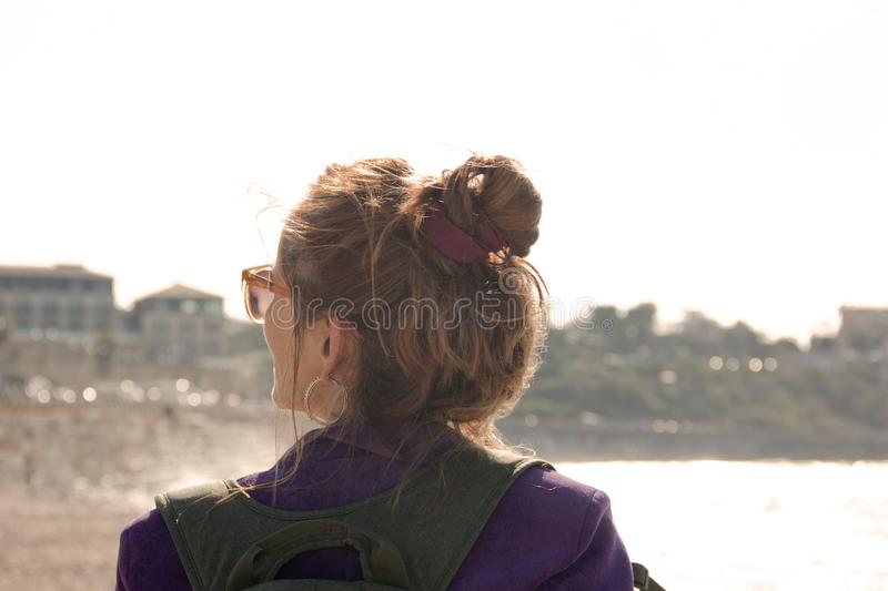 Portrait of a female traveler on the background of the city royalty free stock photo