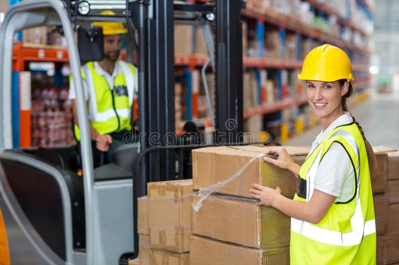 Portrait of female worker smiling royalty free stock photography