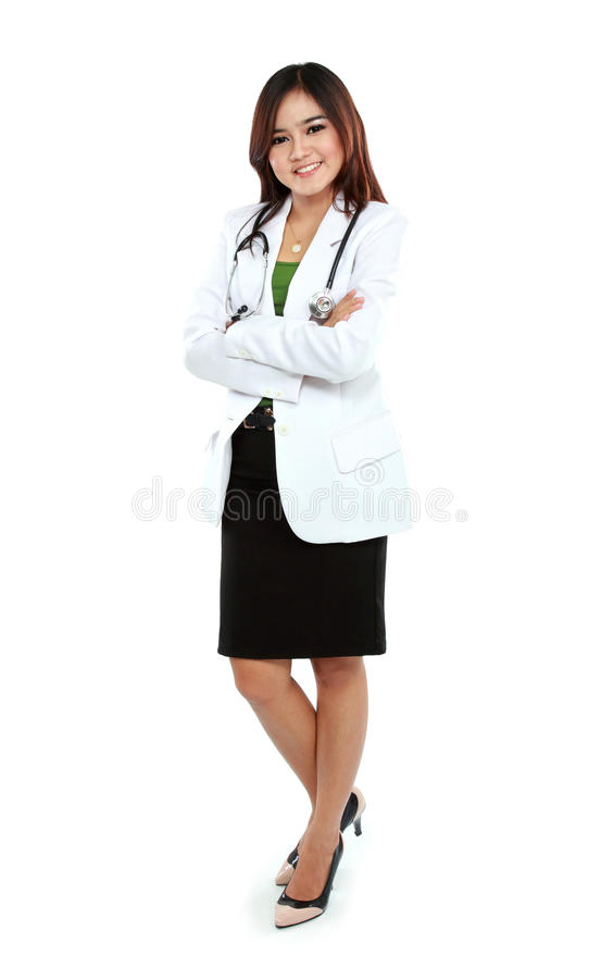Portrait of female young doctor standing with folded arms. Portrait of full lenght female young doctor standing with folded arms royalty free stock image