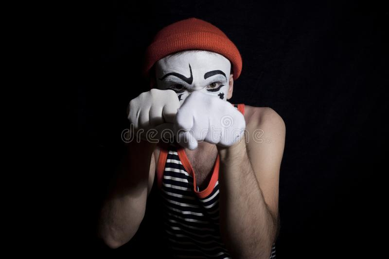 Portrait of fighting mime royalty free stock images