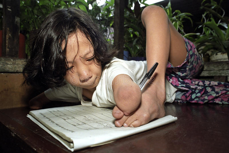 Portrait of Filipino girl who can write with a foot stock photos