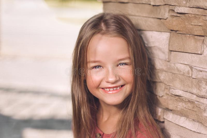 Portrait of fine little girl. happy child smiling stock image
