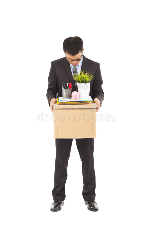 Portrait of a fired businessman carrying a box royalty free stock image