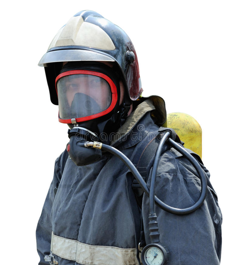 Portrait of a firefighter in breathing apparatus. Portrait of a fire rescuer in a mask with a breathing apparatus included royalty free stock photo