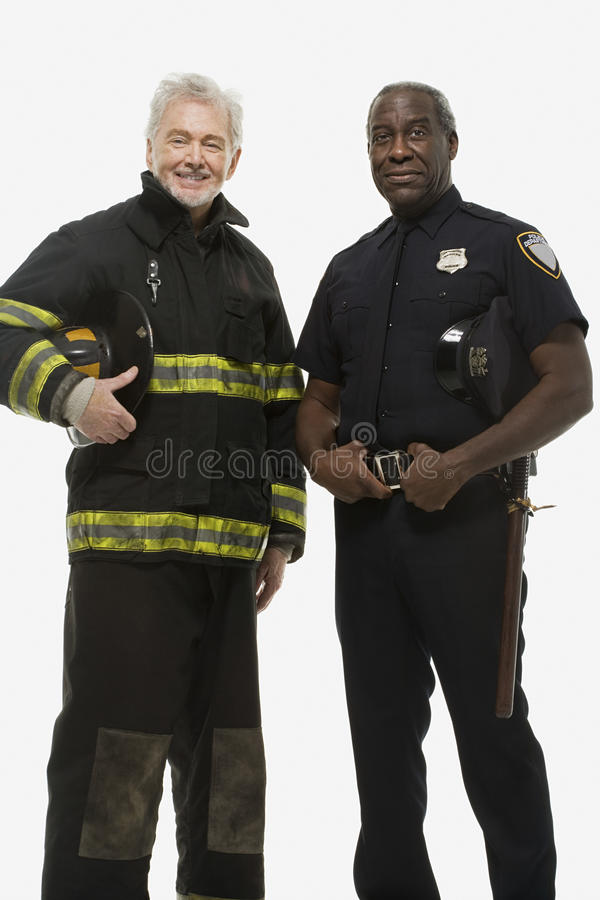 Portrait of a firefighter and a police officer stock image