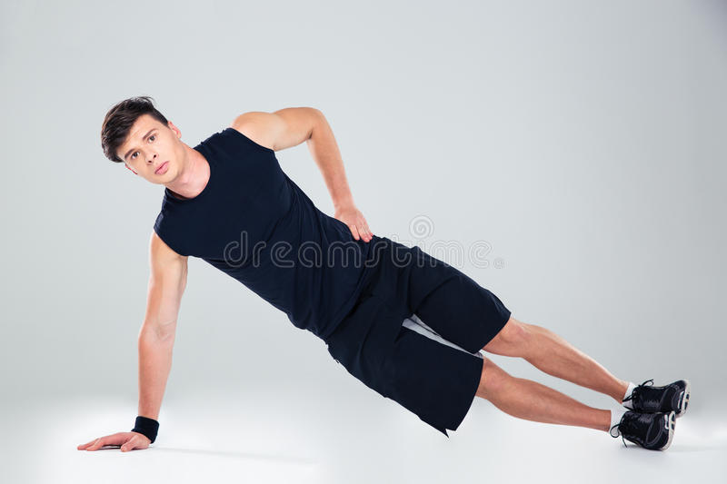 Portrait of a fitness man warming up royalty free stock photos