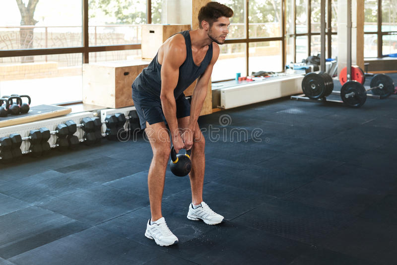Portrait of fitness man with weight stock photos