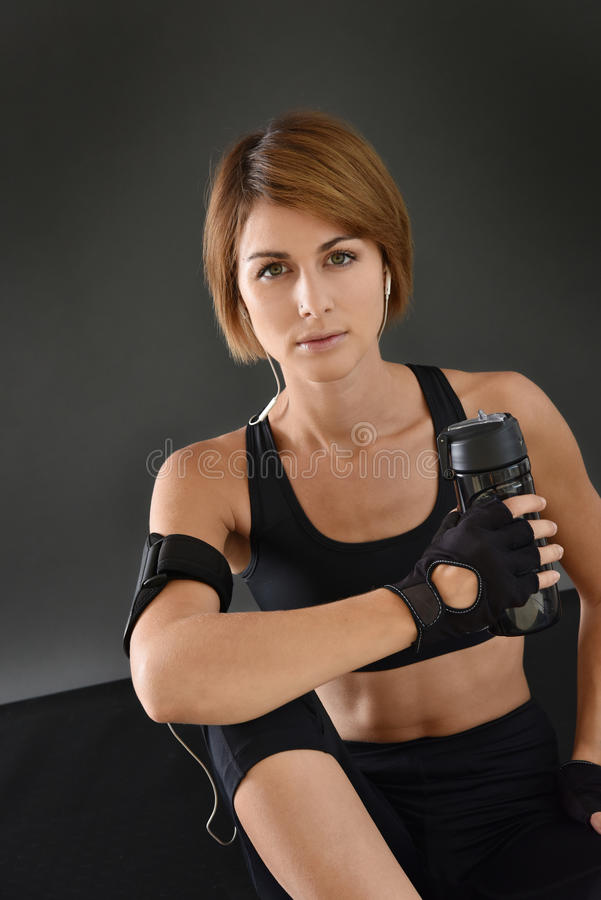 Portrait of fitness woman with bottle royalty free stock image