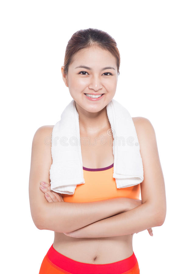 Portrait of fitness young asian woman with towel on White. royalty free stock photos