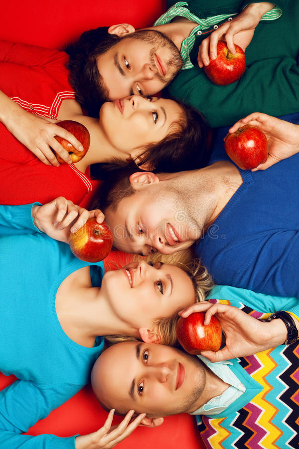 Portrait of five stylish close friends hugging and lying stock images