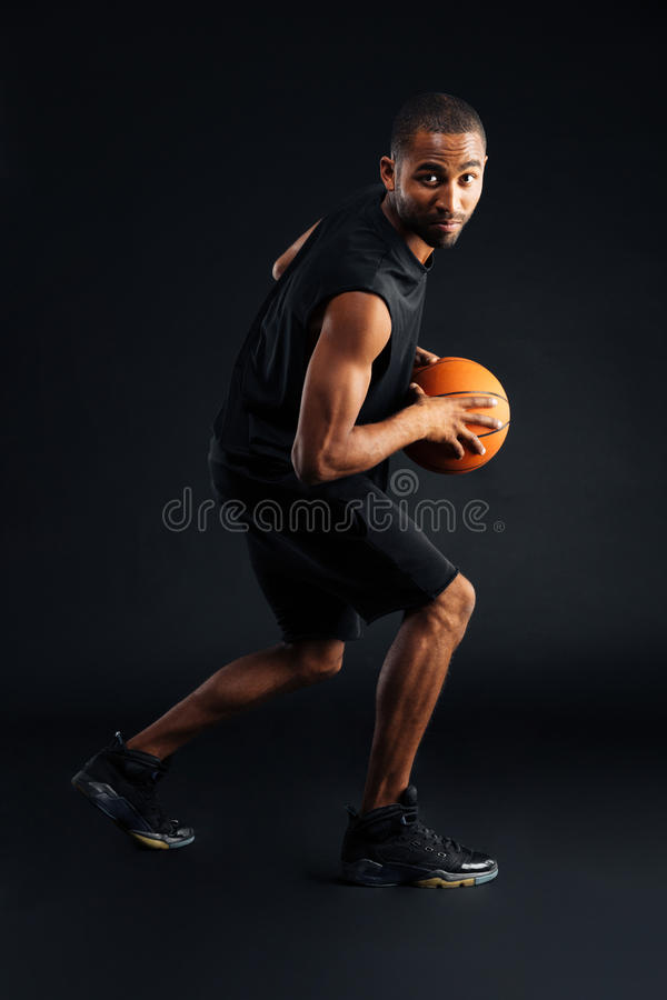 Portrait of a focused african sports man playing in basketball stock photography