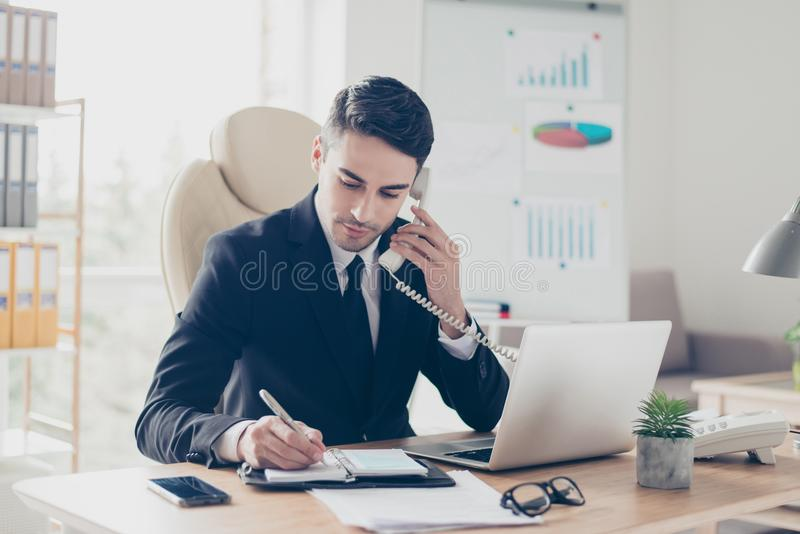 Portrait of focused confident concentrated smart intelligent clever busy expert specialist assistant giving recommendations advice royalty free stock photography