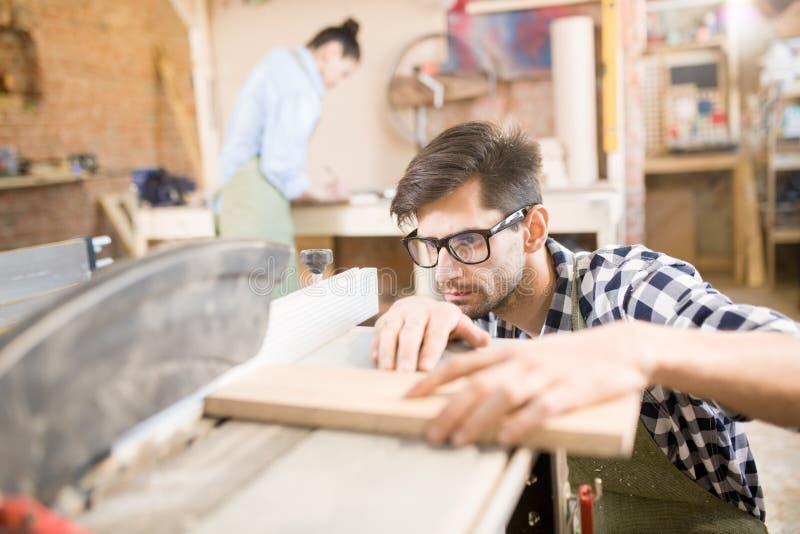 Handsome Carpenter Making Furniture stock photography
