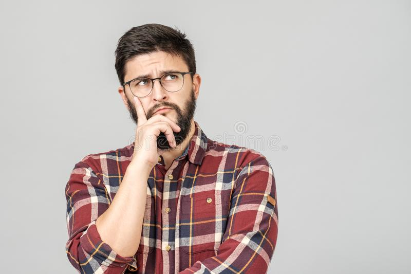 Portrait of focused smart male model with with thoughtful determined expression stock image