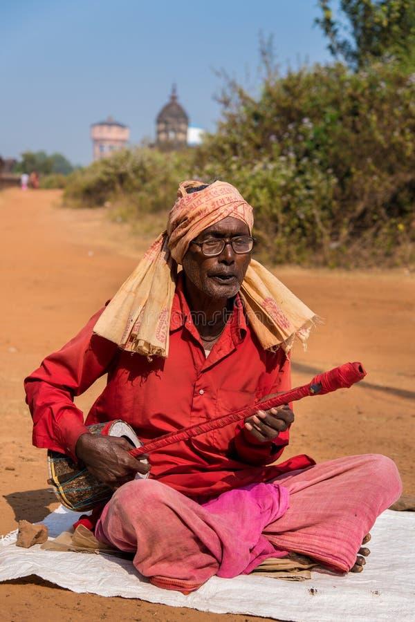 Portrait of a folk singer. BISHNUPUR, INDIA - DECEMBER 20: A Baul - Indian folk singer performs in front of Jorbangla temple on December 20, 2014 in Bishnupur stock images