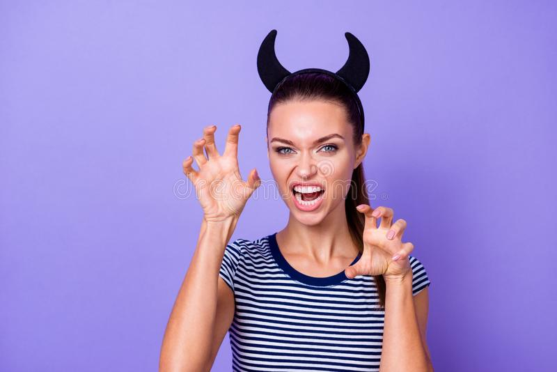 Portrait of foolish insane negative lady character fool weekend free time bad behavior like animal wild striped stock photos