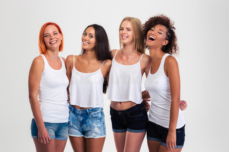 Portrait of a four laughing women stock image