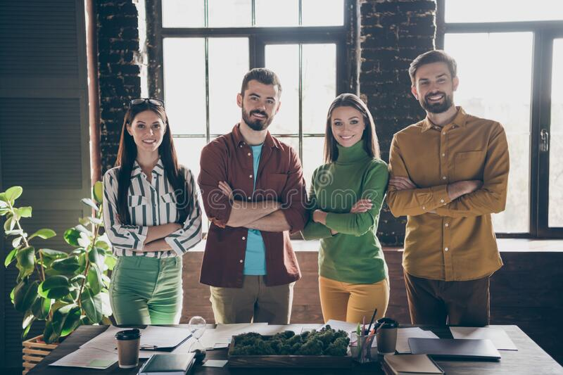 Portrait of four nice attractive friendly content successful cheerful cheery people leaders professional IT specialists. Portrait of four nice attractive royalty free stock images