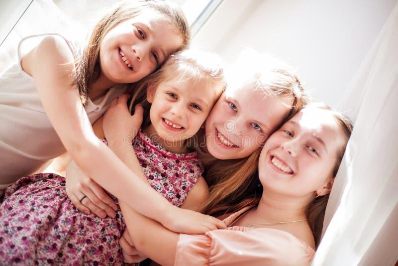Portrait of four sisters stock photos