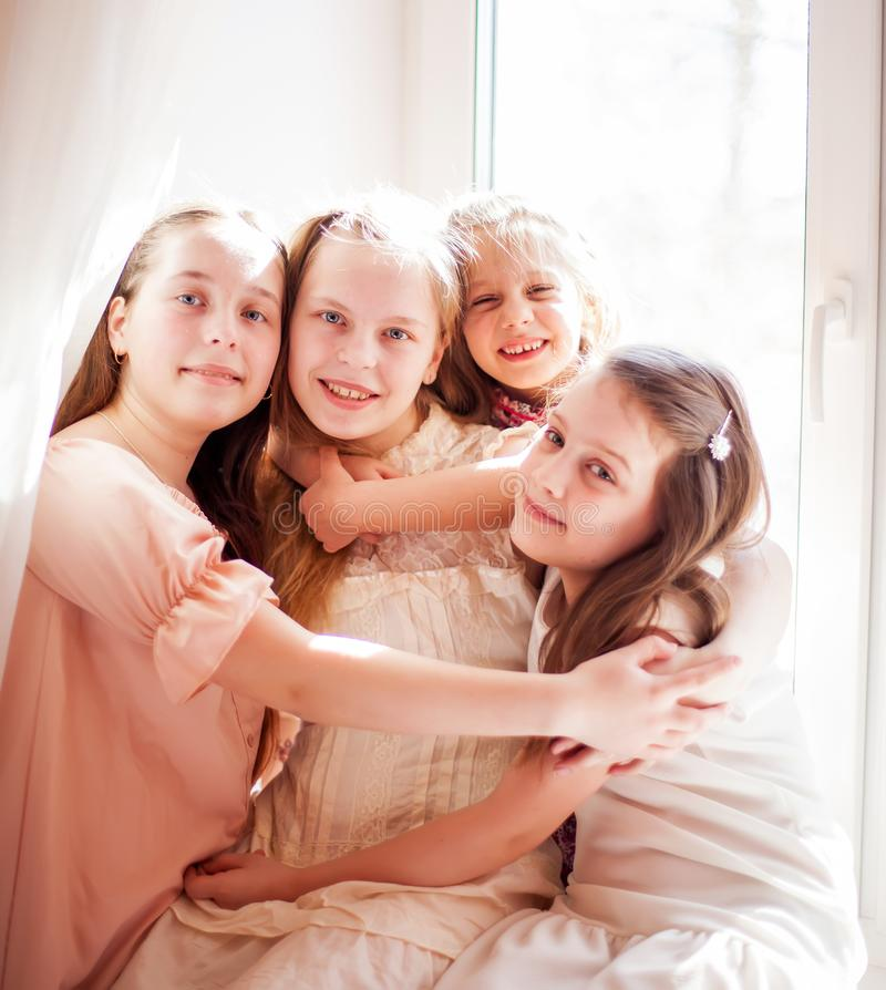 Portrait of four pretty girls  at home stock images