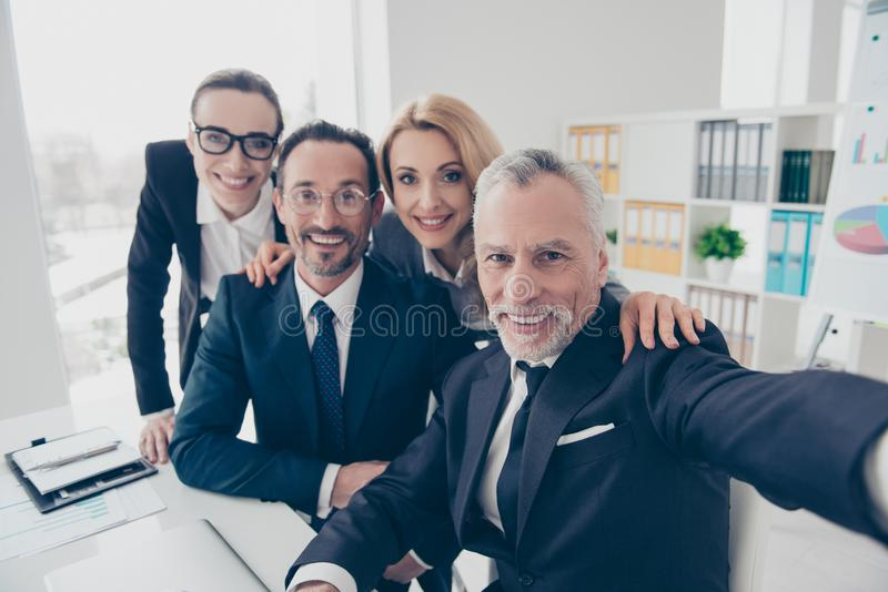 Portrait of four smiling, financial, attractive business people royalty free stock photo